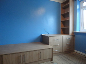 fitted storage space in untidy teenagers bedroom