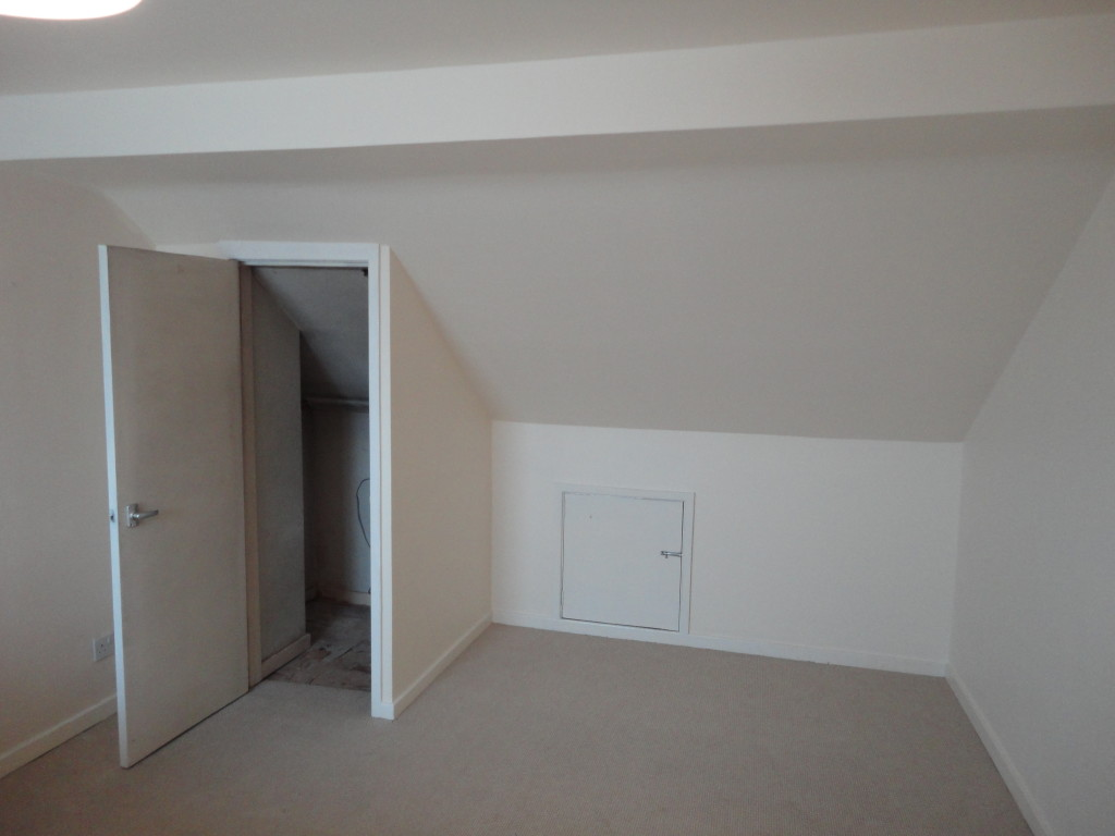 existing cupboard under eaves