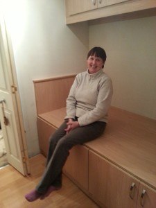 Mrs H sat On cabin Bed
