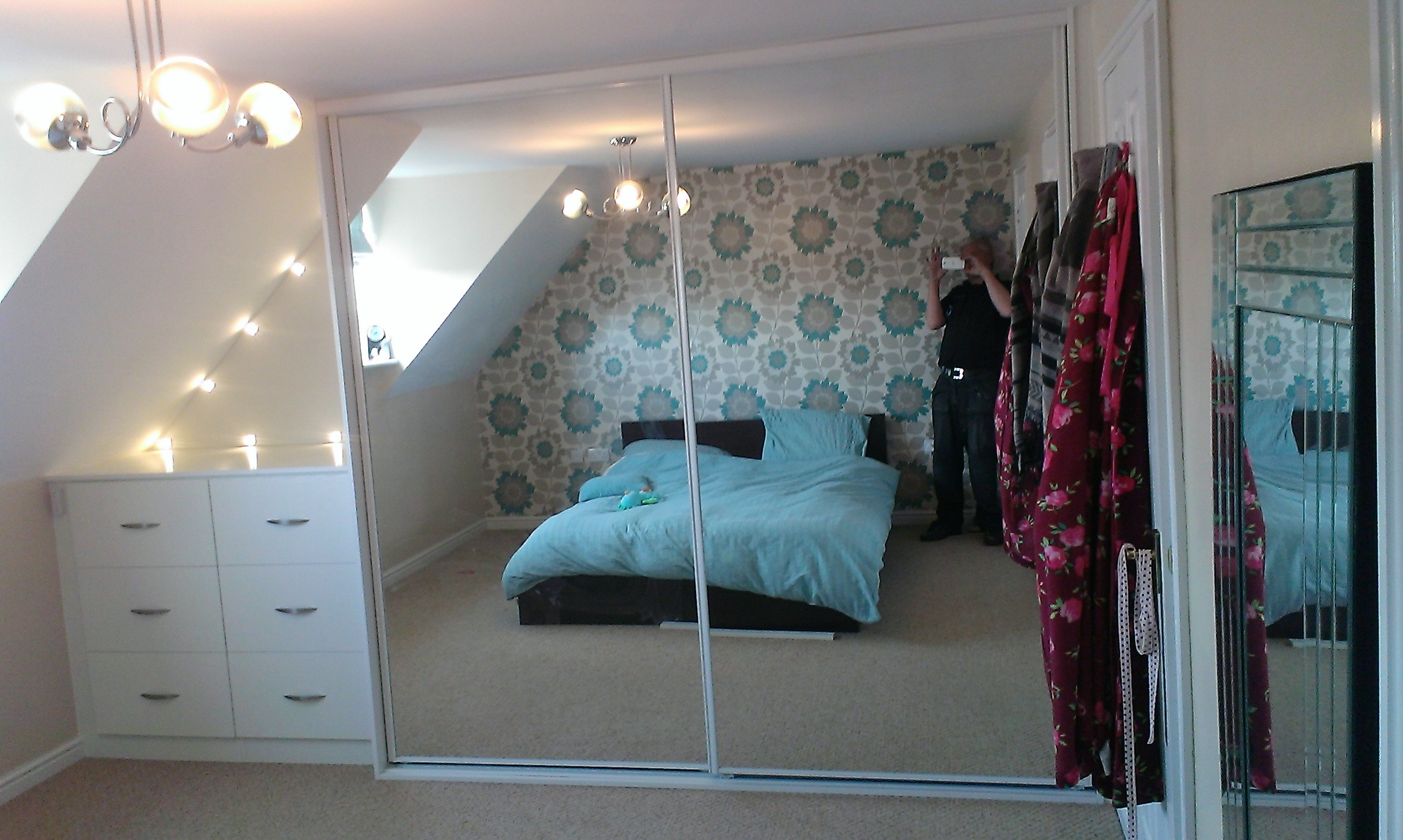 drawers and wardrobe with mirror sliding doors when finished