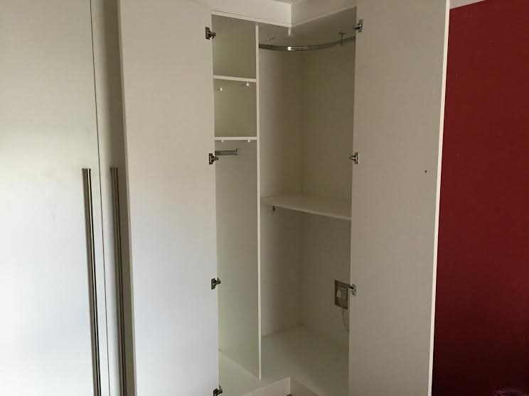 extra bedroom storage space - corner wardrobe