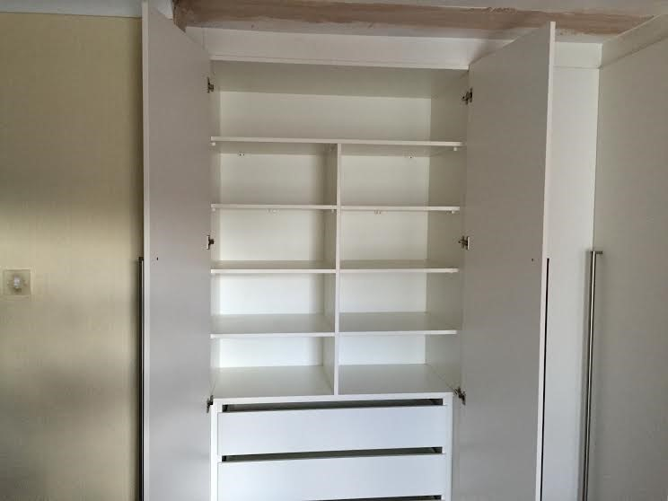extra bedroom storage space-shelving