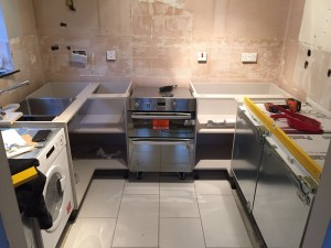 starting to fit fully fitted kitchen