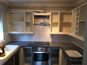 Getting cupboards ready for fully fitted kitchen