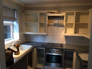 working on fully fitted kitchen