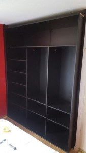 hanging spaces and shelves before sliding doors are fitted