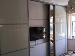4 door sliding wardrobes with tv in place