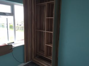 the fitted wardrobe in an alcove from floor to ceiling