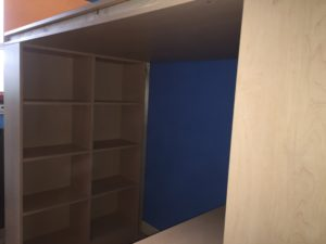 open shelves on high sleeper bed with desk and wardrobe