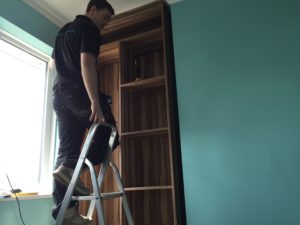 work underway building a fitted wardrobe in an alcove