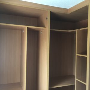 wardrobe fitting into place