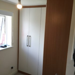 L-shaped wardrobe with fitted doors
