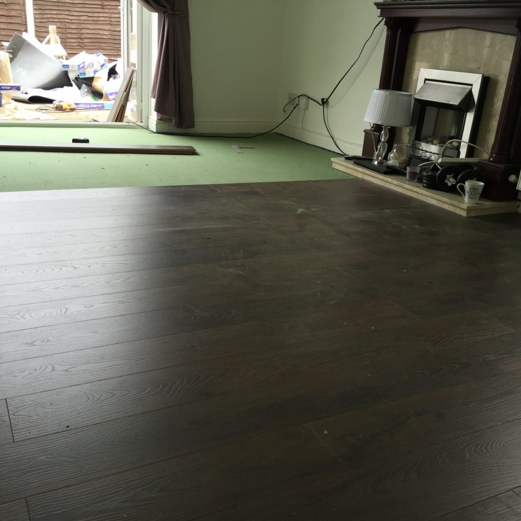 laminate flooring being fitted around the hearth