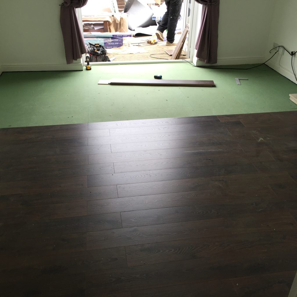 laminate flooring installation in progress
