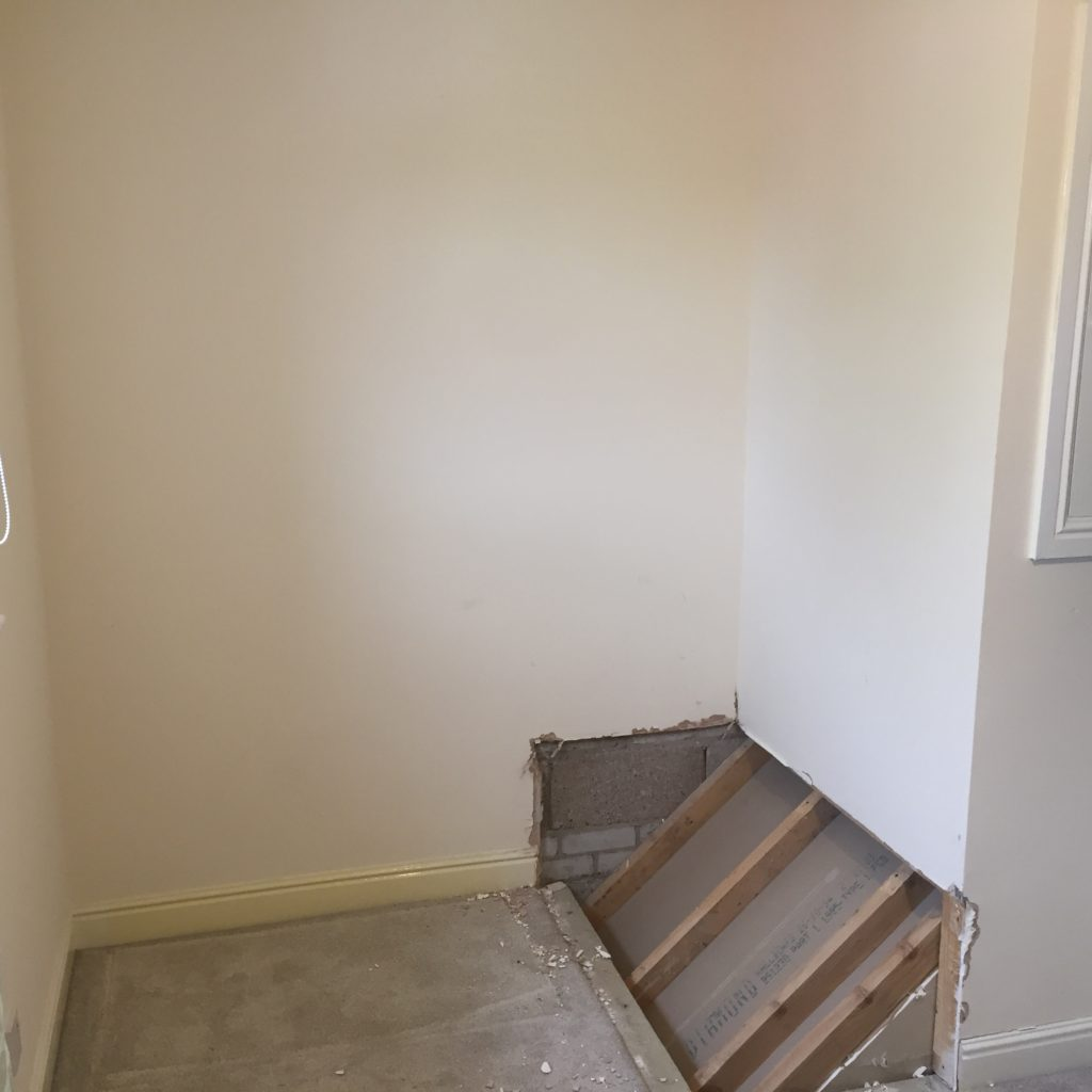 stairs bulkhead exposed in bedroom alcove
