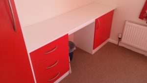 desk with red drawers