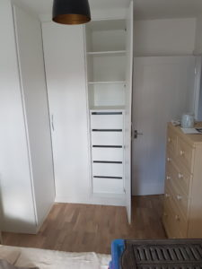 single wardrobe next to corner wardrobe