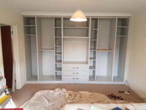 wardrobes showing hanging spaces and drawers
