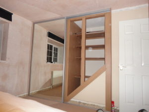 finished wardrobe above stairs bulkhead